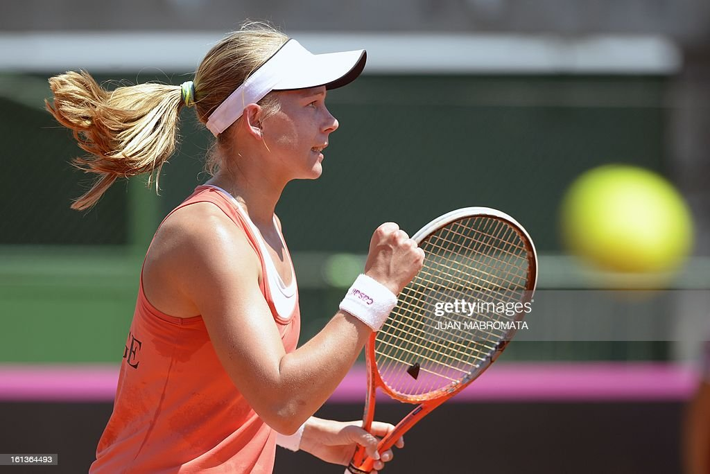 Swedish tennis player Johanna Larsson celebrates a set point against Argentine Florencia Molinero during their 2013 Fed Cup World Group II first round single tennis match at Parque Roca stadium in Buenos Aires on February 10, 2013. AFP PHOTO / Juan Mabromata