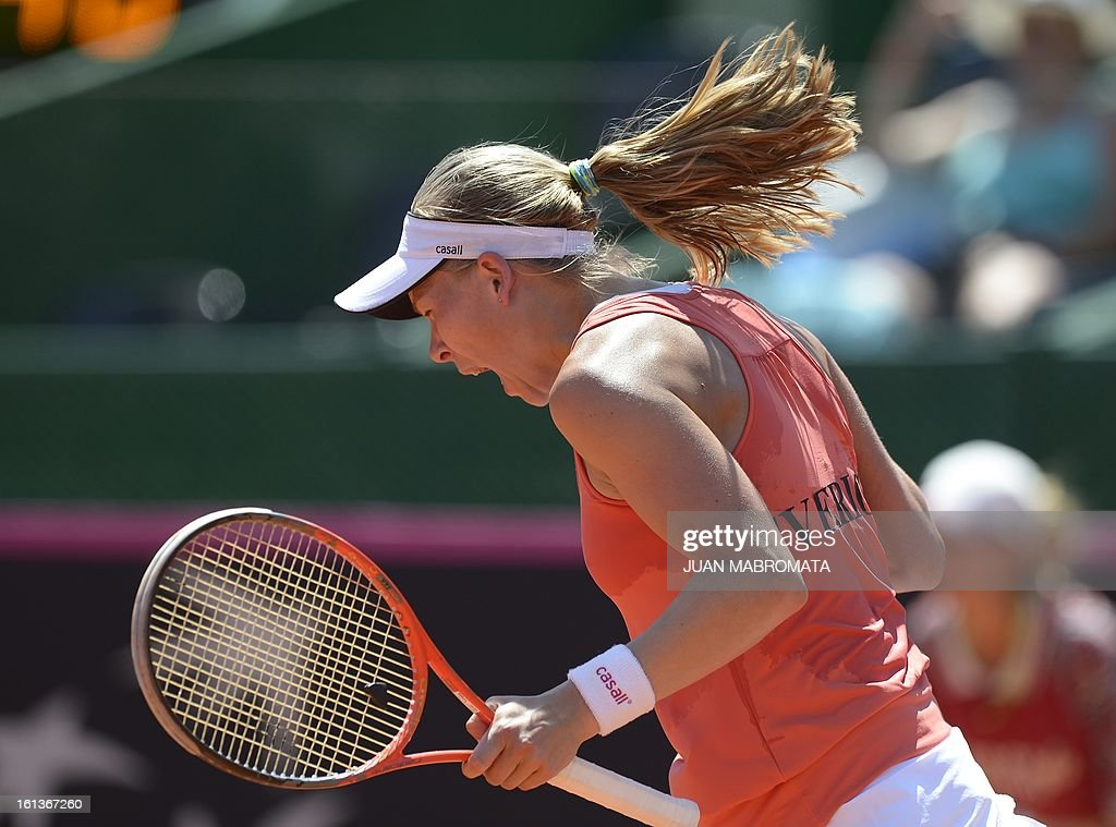 Swedish tennis player Johanna Larsson celebrates after defeating Argentine Florencia in their 2013 Fed Cup World Group II first round single tennis match at Parque Roca stadium in Buenos Aires on February 10, 2013. Larsson won 6-3, 6-2. AFP PHOTO / Juan Mabromata