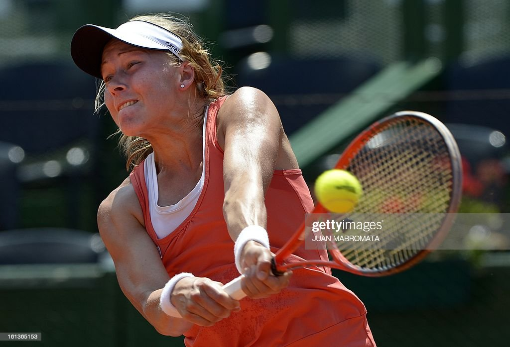 Swedish tennis player Johanna Larsson returns the ball against Argentine Florencia Molinero during their 2013 Fed Cup World Group II first round single tennis match at Parque Roca stadium in Buenos Aires on February 10, 2013. AFP PHOTO / Juan Mabromata