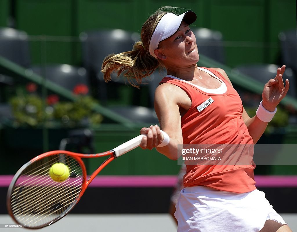 Swedish tennis player Johanna Larsson returns the ball to Argentine Florencia Molinero during their 2013 Fed Cup World Group II first round single tennis match at Parque Roca stadium in Buenos Aires on February 10, 2013. AFP PHOTO / Juan Mabromata