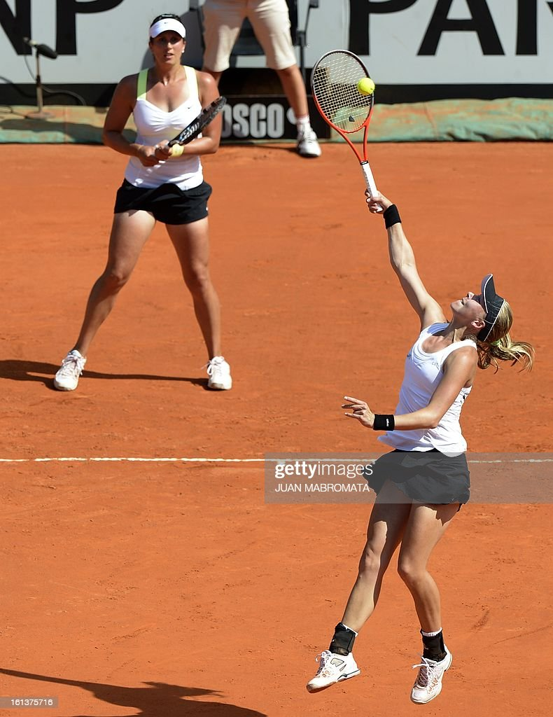 Swedish tennis player Johanna Larsson (R) smashes the ball next to teammate Sofia Arvidsson during their 2013 Fed Cup World Group II first round single tennis match against Argentine tennis players Maria Irigoyen and teammate Mailen Auroux at Parque Roca stadium in Buenos Aires on February 10, 2013. Sweden won by 3-2. AFP PHOTO / Juan Mabromata