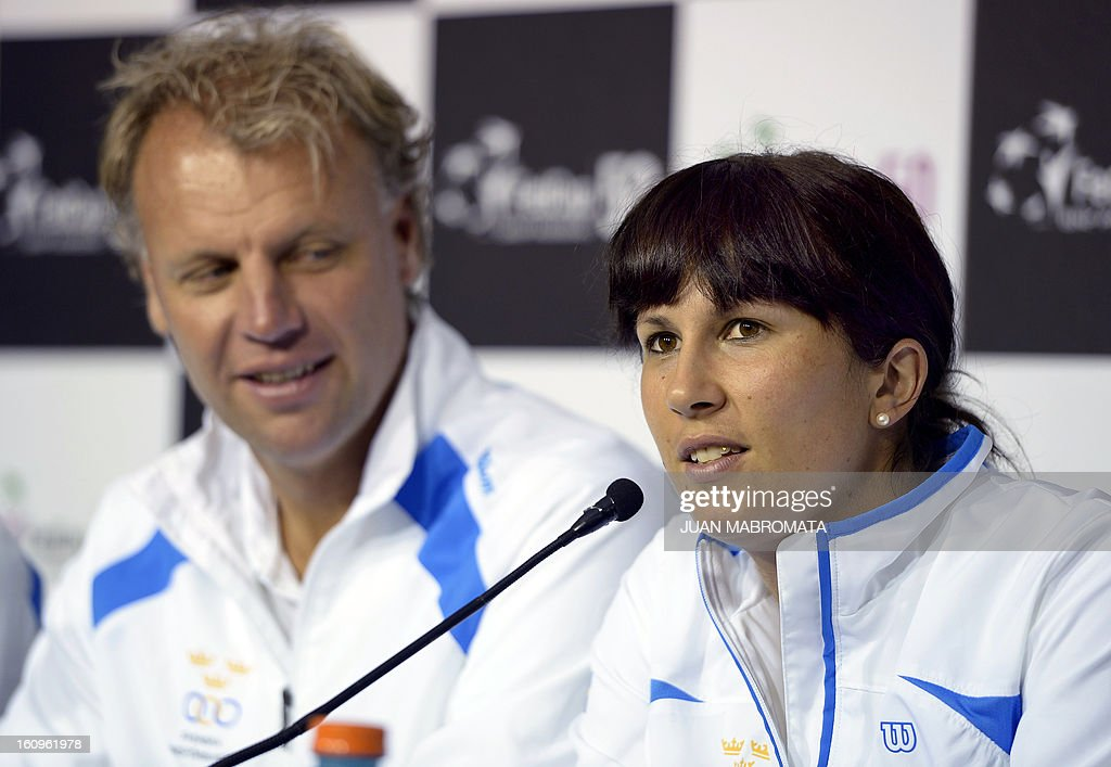 Swedish tennis player Sofia Arvidsson (R) answers questions next to team captain Lars-Anders Wahlgren during a press conference offered after the draw of the 2013 Fed Cup World Group II first round against Argentina to be held this weekend in Buenos Aires, at Parque Roca stadium in the Argentine capital, on February 8, 2012. AFP PHOTO / Juan Mabromata