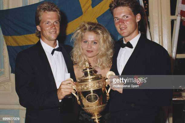 Swedish tennis player Stefan Edberg men's champion at the 1990 Wimbledon Championships pictured wearing formal evening wear with his girlfriend...