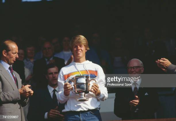 Swedish tennis player Stefan Edberg pictured holding the trophy after defeating John Frawley of Australia 63 76 in the final of the Boys' Singles...