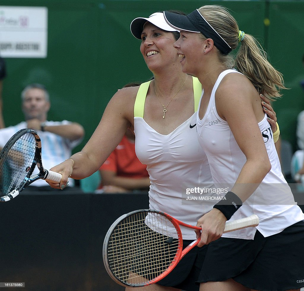 Swedish tennis players Johanna Larsson (R) and teammate Sofia Arvidsson celebrate after defeating Argentine tennis players Maria Irigoyen and teammate Mailen Auroux by 6-4, 6-4 in their 2013 Fed Cup World Group II first round single tennis match at Parque Roca stadium in Buenos Aires on February 10, 2013. Sweden won by 3-2. AFP PHOTO / Juan Mabromata