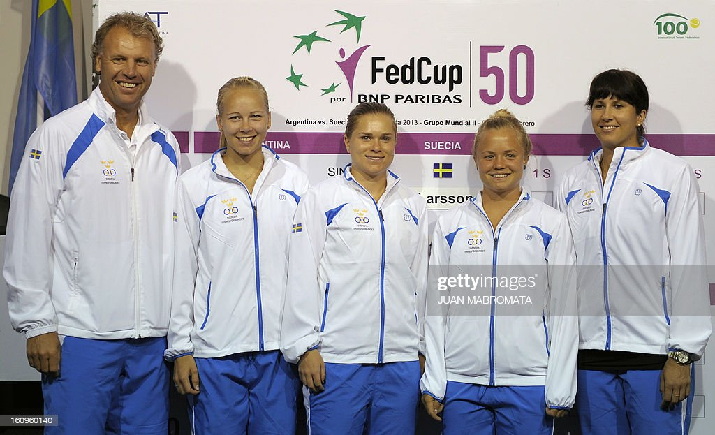 Swedish tennis players (R-L) Sofia Arvidsson, Hilda Melander, Sandra Roma, Johanna Larsson and team captain Lars-Anders Wahlgren pose for pictures after the draw of their 2013 Fed Cup World Group II first round against Argentina, to be held this weekend in Buenos Aires, at Parque Roca stadium in the Argentine capital, on February 8, 2012. AFP PHOTO / Juan Mabromata