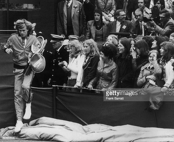 Swedish tennis star Bjorn Borg arrives on court at Wimbledon for his match against Ross Case of Australia 27th June 1974