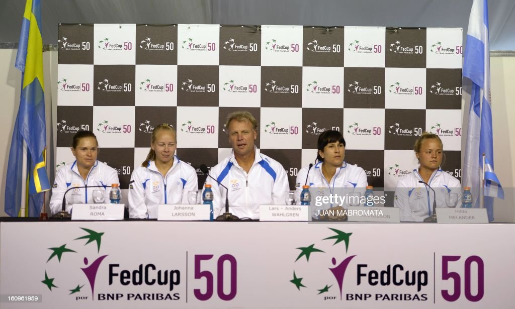 Swedish tennis team (L-R) Sandra Roma, Johanna Larsson, Swedish tennis captain Lars-Anders Wahlgren, tennis players Sofia Arvidsson and Hilda Melander give a press conference after the draw of the 2013 Fed Cup World Group II first round against Argentina to be held this weekend in Buenos Aires, at Parque Roca stadium in the Argentine capital, on February 8, 2012. AFP PHOTO / Juan Mabromata