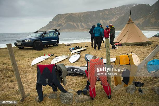 Swedish tourists chat near their tent after a surfing session in Unstad beach in the Lofoten Islands within the Arctic Circle on April 17 2015...