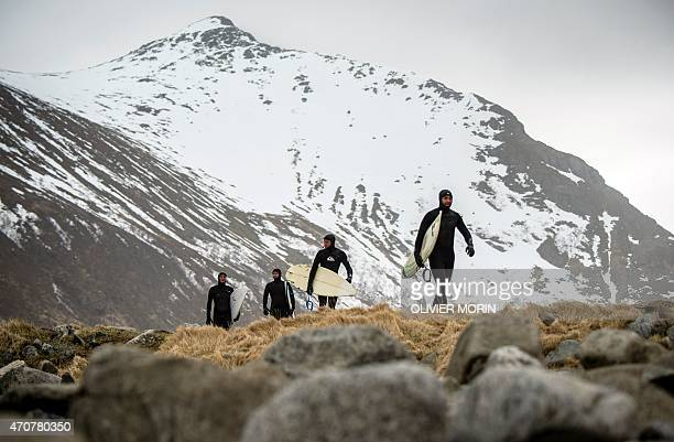 Swedish tourists walk back to their tent after a surfing session in Unstad beach in the Lofoten Islands within the Arctic Circle on April 17 2015...