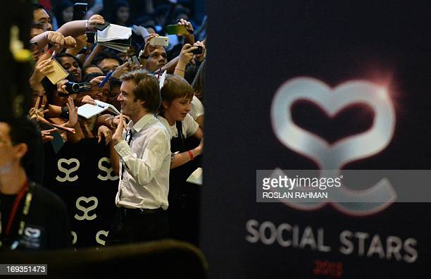 Swedish video game commentator Felix Kjellberg aka PewDiePie acknowledges his fans as he arrives to attend the Singapore Social Star Awards at the...