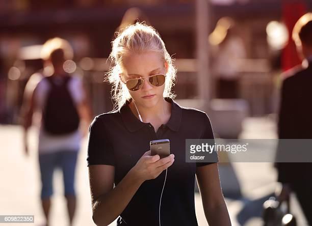 Swedish young woman, using mobile smart phone