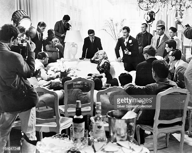 SwedishAmerican actress Anita Ekberg surrounded by reporters as Sylvia in 'La Dolce Vita' directed by Federico Fellini 1960