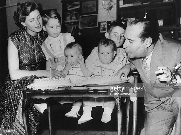 Swedishborn actor Ingrid Bergman and Italian film director Roberto Rossellini celebrate the first birthday of their twin daughters Isabella and...