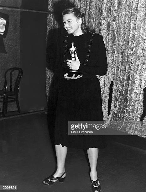 Swedishborn actor Ingrid Bergman holds her Oscar for Best Actress for her role in the film 'Gaslight' at the Academy Awards Hollywood California...