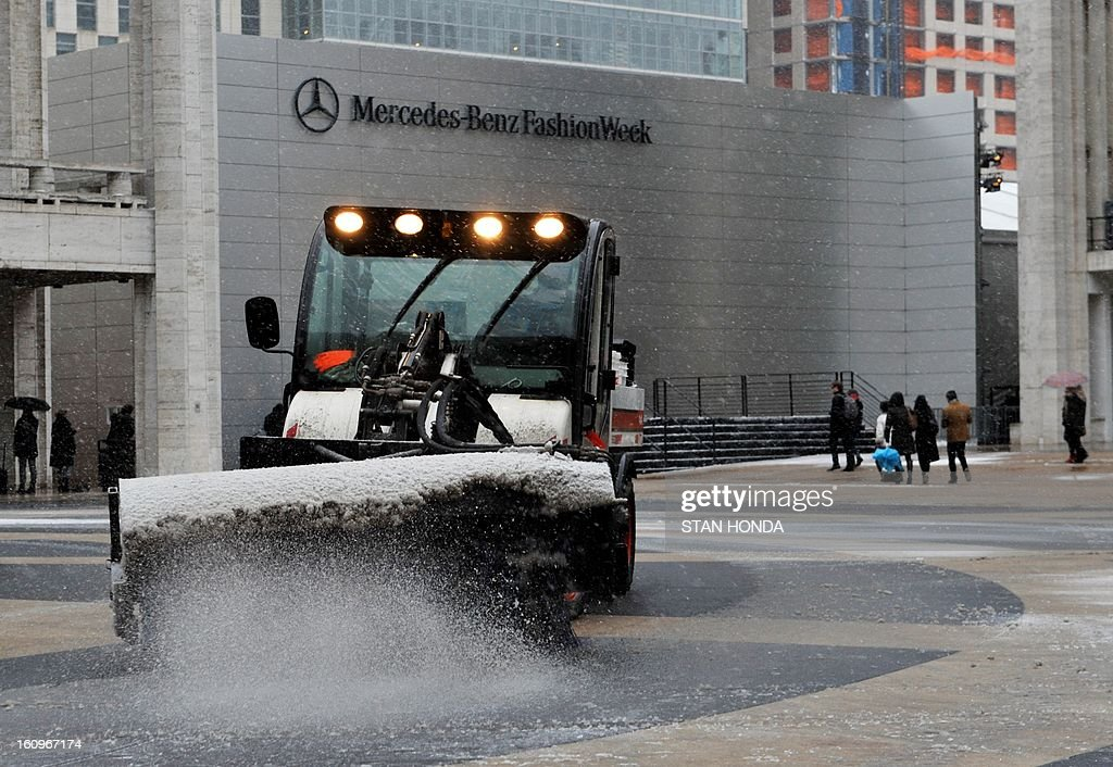 A sweeper clears snow on the plaza in front of the Mercedes Benz Fashion Week tents on February 8, 2013 at Lincoln Center in New York. The first flurries fell Friday over New England in what was forecasted to be an intense snow storm with white-out conditions, fierce winds and significant travel snarl-ups over the next 24 hours. The National Weather Service predicted 'a major winter storm with blizzard conditions' along most of the region's coastline, including the New York area. AFP PHOTO/Stan HONDA