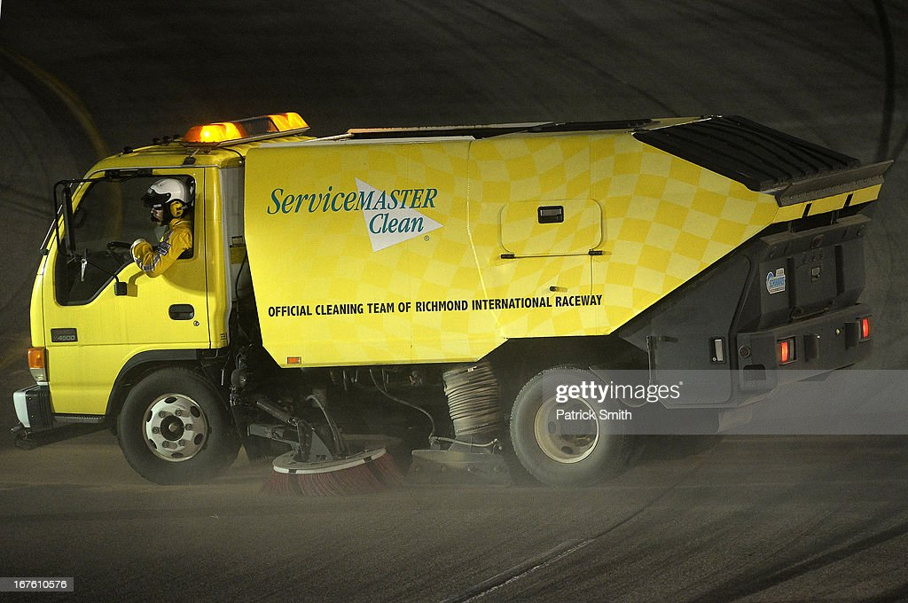 A sweeper truck cleans after a crash during the NASCAR Nationwide Series ToyotaCare 250 at Richmond International Raceway on April 26, 2013 in Richmond, Virginia.