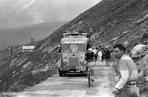 A sweeper truck follows the last cyclist during the Tour de France