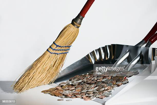 Sweeping coins into dust pan