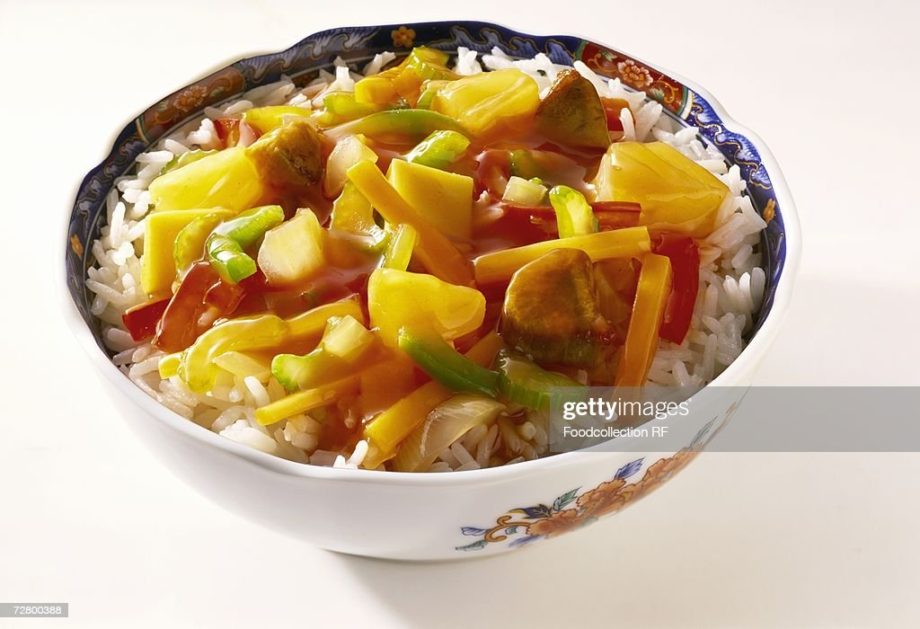 Sweet and sour meat and vegetable stir-fry on rice : Stock Photo
