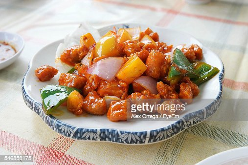 Sweet And Sour Pork Served In Plate On Tablecloth