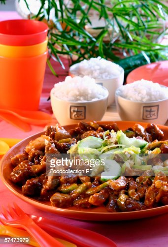Sweet and sour pork with three bowls of rice : Stock Photo
