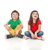 Adorable boy and girl having great time, isolated on white