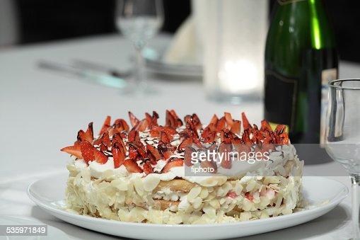sweet cake in bright interior : Stock Photo