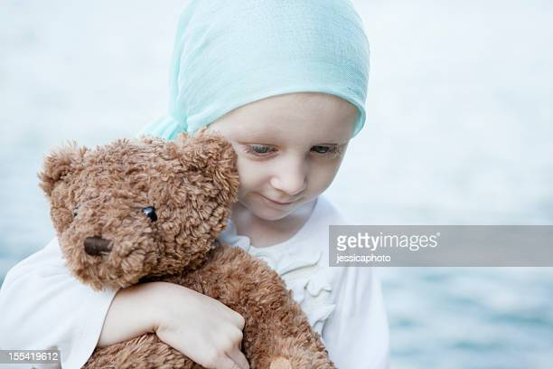 Sweet Chemo Girl Hugs Teddy Bear