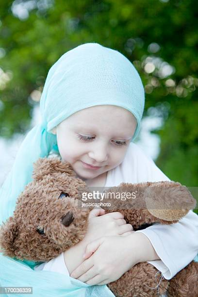 Sweet Chemo Girl Hugs Teddy Bear Vertical