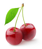 Two sweet cherries isolated on white.