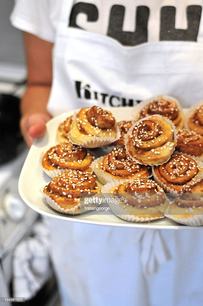 Sweet cinnamon Swedish treat in chefs hands
