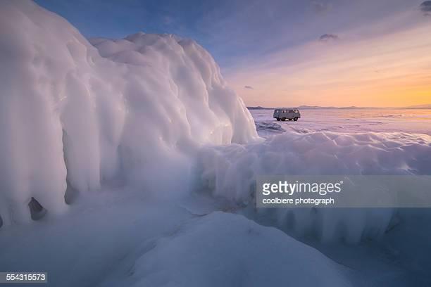 Sweet color sunset at frozen Baikal lake