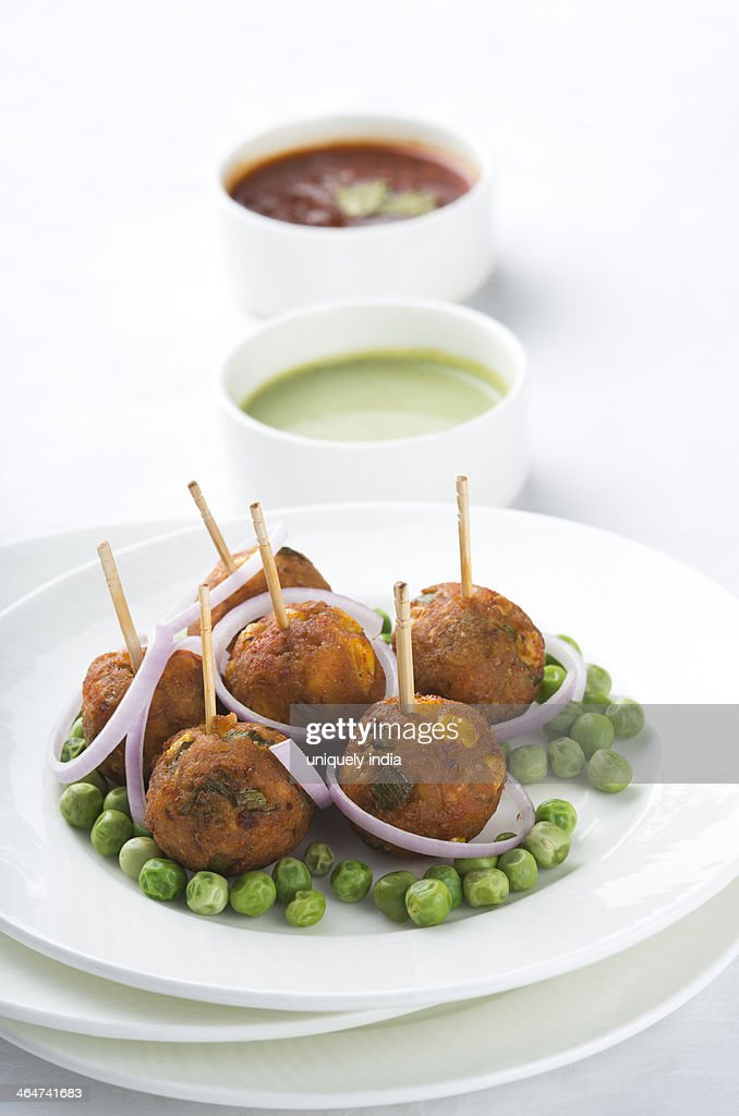 Sweet Corn Balls served with pea pods in a plate : Stock Photo