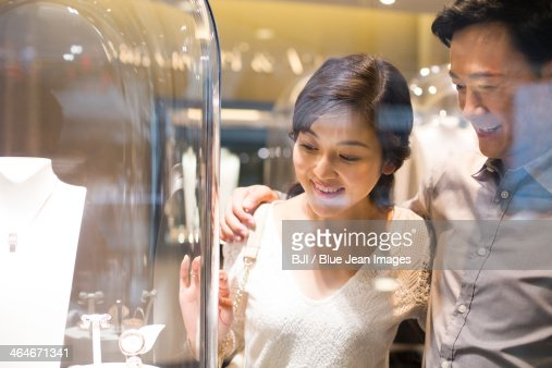 Sweet couple in jewelry store