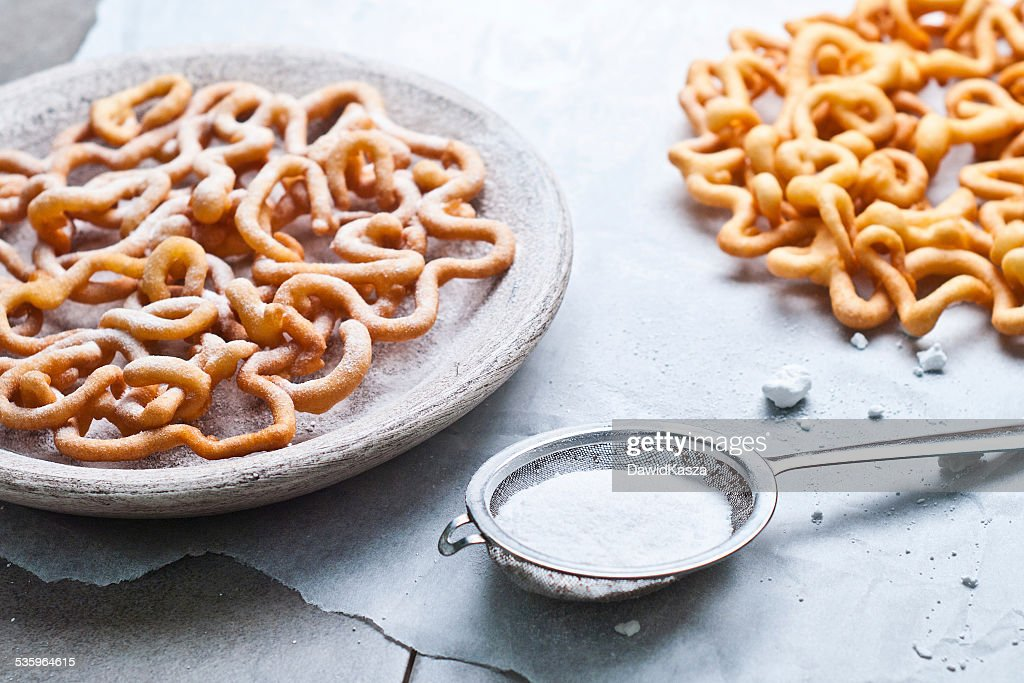 sweet crisp pastry deep fried and sprinkled with powdered sugar : Stock Photo