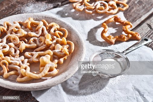sweet crisp pastry deep fried and sprinkled with powdered sugar. : Stock Photo
