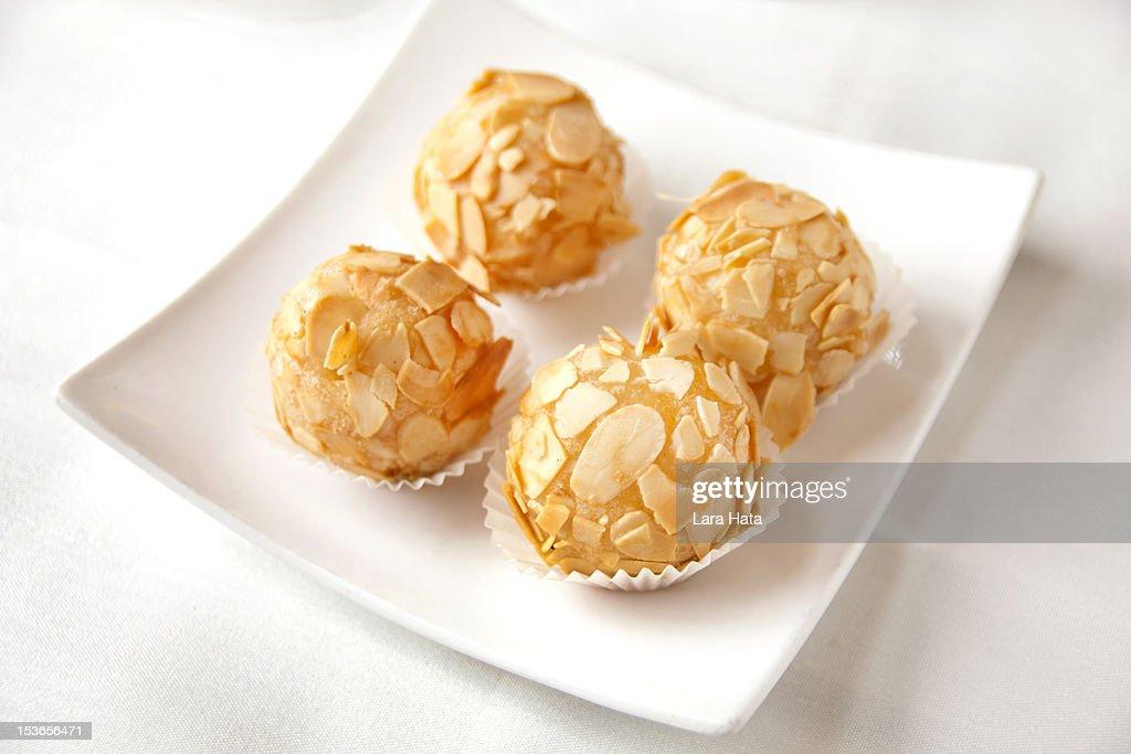 Sweet egg yolk and almond balls : Stock Photo