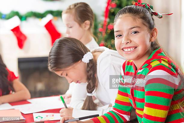 Sweet elementary age girl works on Christmas crafts