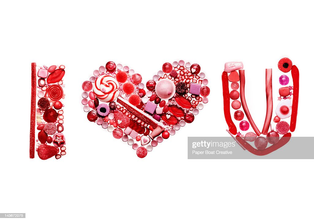 sweet food and candy spelling out I love you : Stock Photo