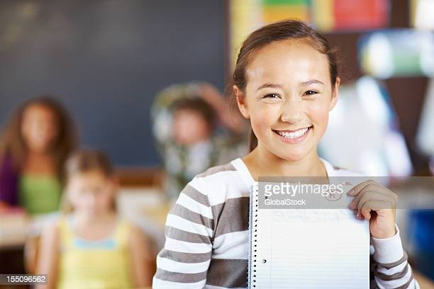 Sweet girl holding paper