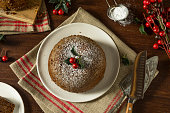 Sweet Homemade Christmas Figgy Pudding with Powdered Sugar