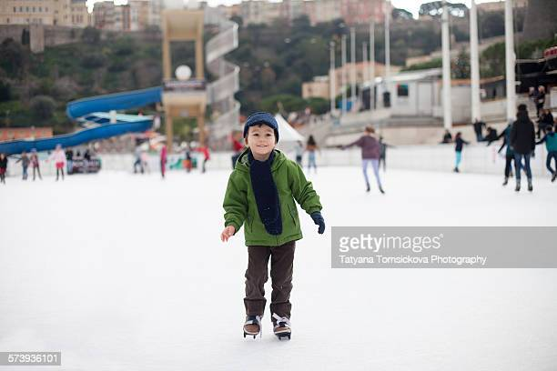 Sweet little boy, learning ice skating, outdoors
