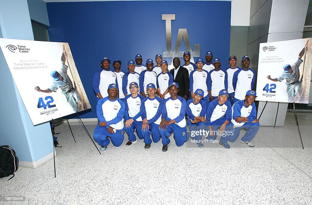 'Sweet' Lou Johnson (C) and the Crenshaw High School Baseball Team pose for a photo during Time Warner Cable & ASPIRE Partner to give a Southern California High School Student the opportunity to win a scholarship event at Dodger Stadium on April 15, 2013 in Los Angeles, California.
