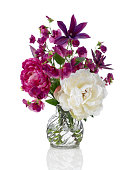 Sweet pea, peony and Clematis bouquet on white background