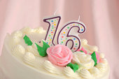 A festively decorated cake for a sixteenth birthday or anniversary.More images of Sweet Sixteen cakes: