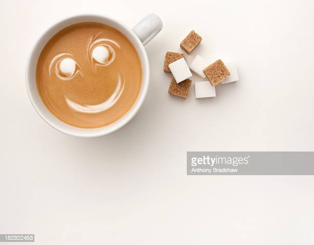 Sweet smiling cup of coffee and sugar
