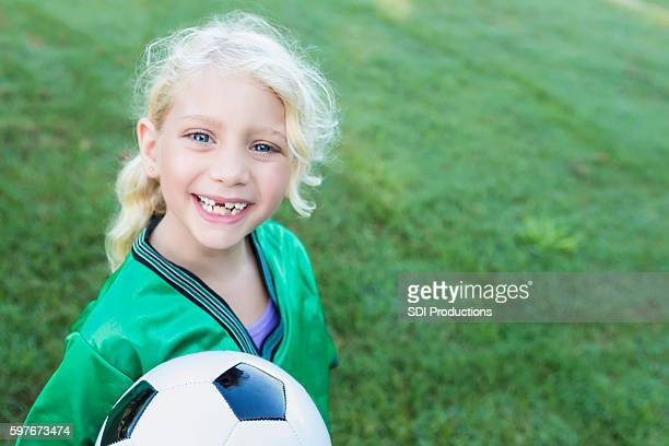 Sweet soccer girl with missing teeth