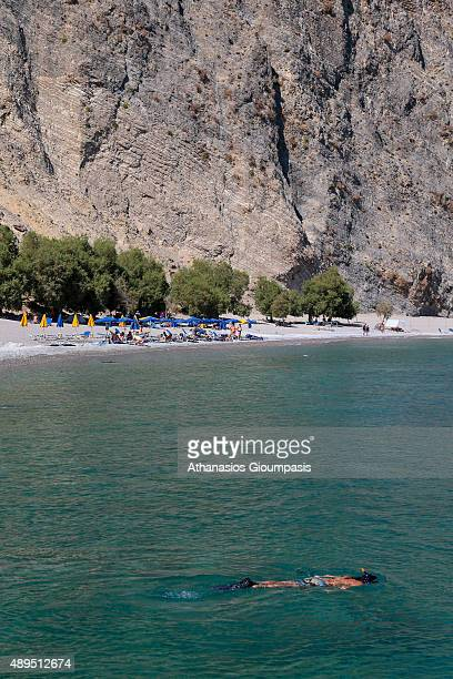 Sweet water beach or Glykanera on July 16 2015 in Crete GreeceBeach located about halfway between Loutro and Hora Sfakion Naturism allowed and is a...