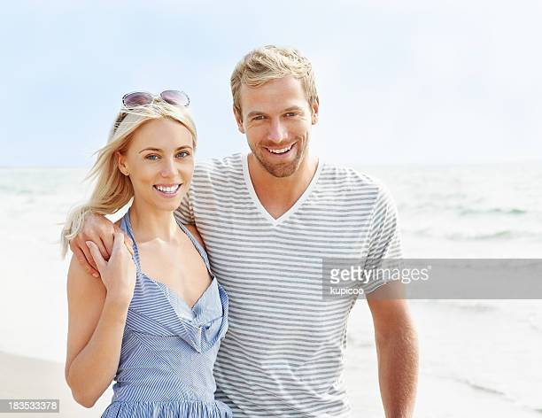Sweet young couple enjoying their vacation on beach